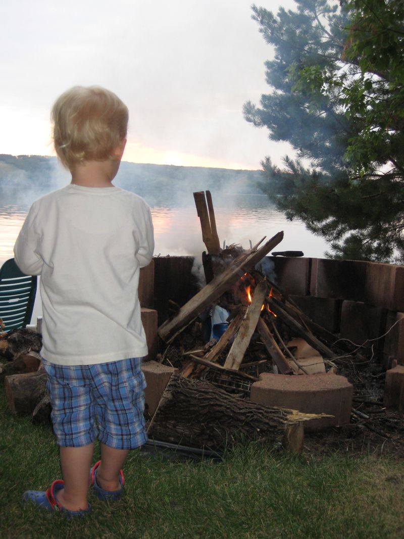Andrew contemplates the fire at sunset